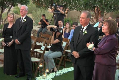 Parents Watch Their Daughter Get Married, Immediately Confused When Priest Says 'Stand Up'