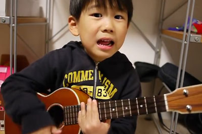 When This Little Boy Plays The Ukulele, Nobody Can't Help But Smile From Happiness