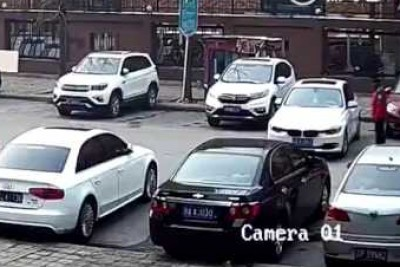 Woman With BMW Hits Cars Out Of Parking Space