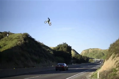 VIDEO: Daredevil Dirt Bike Rider Jumps Across Busy Highway In California