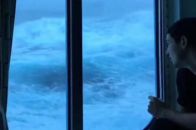 Surprisingly Chill Passengers Watch Huge Waves Batter Their Third-Floor Cruise Ship Window