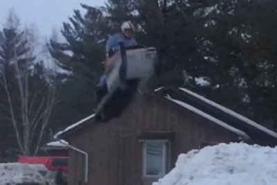 Guy Crashes Hard On Snowmobile Jump, Then He Does It Again