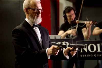 Russian Conductor Plays Classical Music With Two Guns