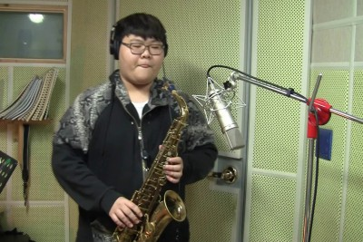 This Kid's Sax Cover Of 'Livin' On A Prayer' Will Melt Your Face Off