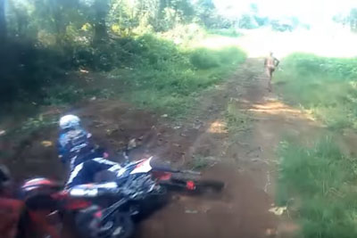 WATCH: Biker Crashes Into Mysterious Creature In The Jungle