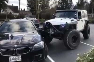 Jeep Driver Pushes Expensive BMW Into Parking Space