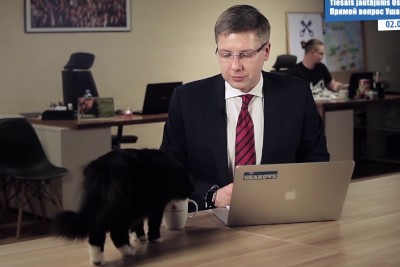 Cat Steals The Whole Show When Latvian Politician Speaks Out To People