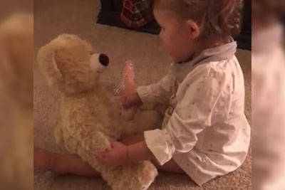 Baby Girl Gets Bear From Deployed Daddy, Watch Her Flip Out When She Squeezes Its Hand