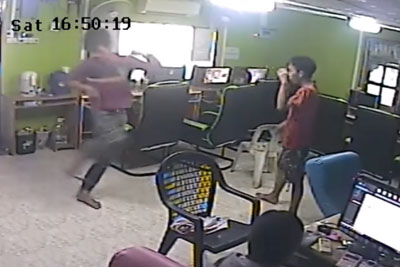 Huge Snake Attacks Man Leaving Internet Cafe
