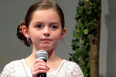 "Little Girl Changes Words To ""Hallelujah,"" Paralyzes Crowd With Her Haunting Version"