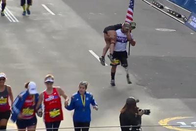 Veteran With Prosthetic Leg Carries Guide Across Boston Marathon Finish Line