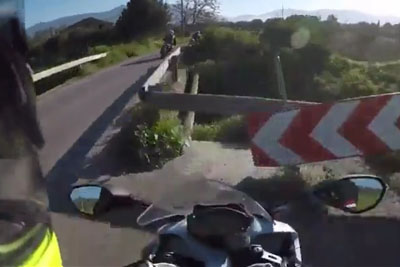 Biker Can't Handle Sharp Turn And Pays The Price