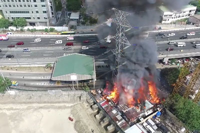 Dramatic Drone Video Of A Flaming High-Voltage Power Line Falling Over In A City