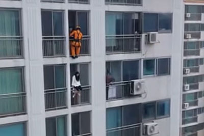 Heroic Firefighter Saves A Life Of Suicidal Woman Trying To Jump Off Her Balcony