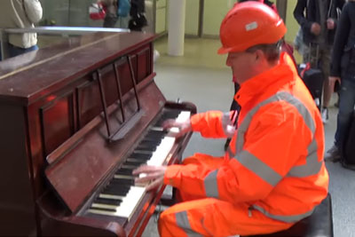 Worker Walks Humbly Up To Street Piano, Within Seconds Sends Chills Down Everyone's Spine
