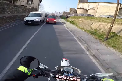 Italian Motorcyclist Captures Dangerous Close Call After Woman Overtakes Over Solid Line