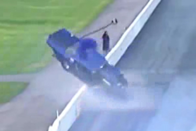 Drag Car Crashes Into Wall Almost Hitting Unsuspecting Cameraman