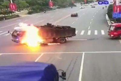 Motorcyclist From China Crashed Into Truck, Causing Both Vehicles To Explode