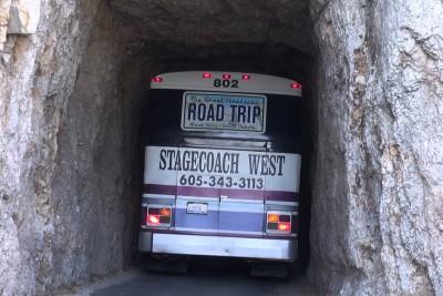 Bus Drives Through Narrow Tunnel In South Dakota