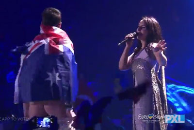 WATCH: Eurovision Streaker In Australian Flag Drops His Pants After Crashes Eurovision Stage