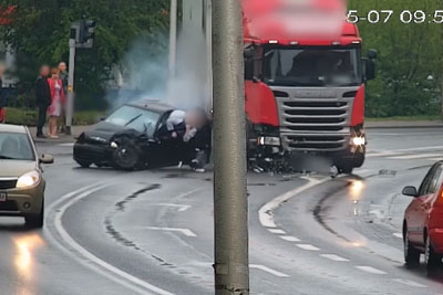 Semi Truck Runs Red Light And Causes Brutal Crash Where Driver Gets Ejected From The Car