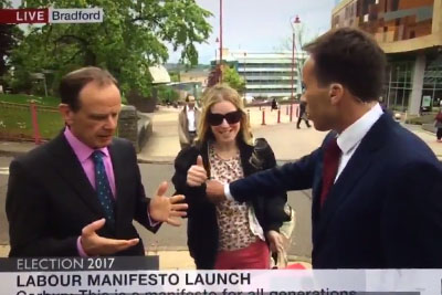 BBC Reporter Tries To Push Woman Away, Accidentally Gropes Her