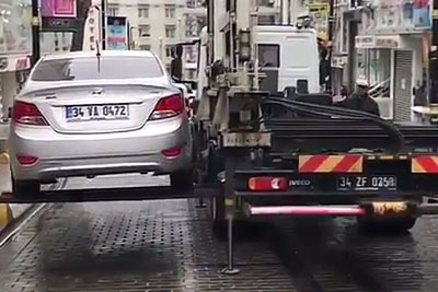 This Tow Truck Can Take Away Your Car In Just Few Seconds