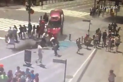 Watch How Pedestrians Stop And Beat Driver Who Crashed His Car On Times Square