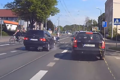 Speeding BMW Driver Gets Instant Karma After Almost Hitting Pedestrians