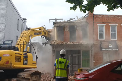 Demolition Crew Accidentally Knocks Down The House Next To The One They're Supposed To Be Demolishing