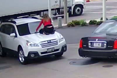 Woman Jumps On Hood In Attempted Carjacking, Gets Her Car Back