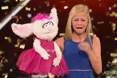 12-Year-Old Singing Ventriloquist Gets Golden Buzzer On AGT, Bursts In Tears