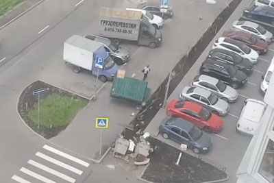 Guy Narrowly Escapes Getting Crushed By Flying Dumpster, Walks Away Like Nothing Happened