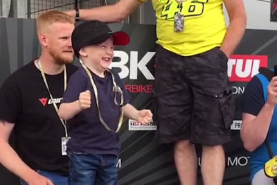 Little Kid Goes Crazy When Professional Rider Puts Him On His Bike