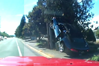 Camaro Gets Road Justice, Ends Up A Pole After Brake Checking