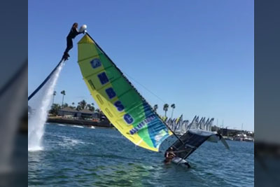 A Jetboarder Flips A Capsized Catamaran Back Up Like There's Nothing To It