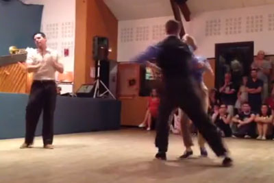 He Grabs Her Hand To Dance - But Watch The Man In The White Shirt Behind Them