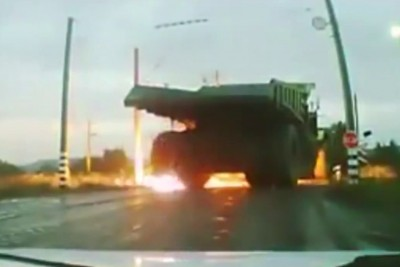 Dump Truck Drives Into High Voltage Power Line