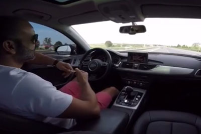 Stupid Driver Uses Only His Knees To Steer While Speeding With His Audi On The Highway