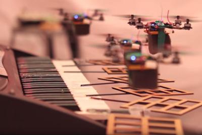 Robot Quadrotors Perform James Bond Theme