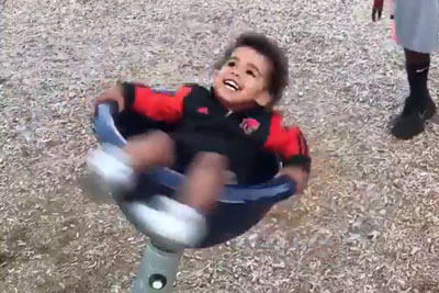 Child Makes His Parents Laugh As Hell After Spinning On Children's Playground