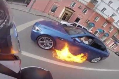 BMW Catches On Fire, Then Driver Tries To Drive Fast To Put The Fire Out