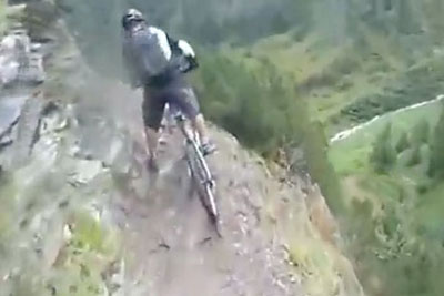 Horrifying Moment As Biker Loses His Balance And Falls Off A Cliff