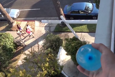 Guy Throws Water Balloon On Strangers, Footage Is Hilarious