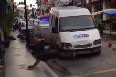 Van Ploughs Through The Streets In Malaysia, Pedestrians Jump Away In Last Second