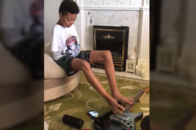WATCH: This Kid Has No Arms But That Doesn't Stop Him From Achieving His Goals