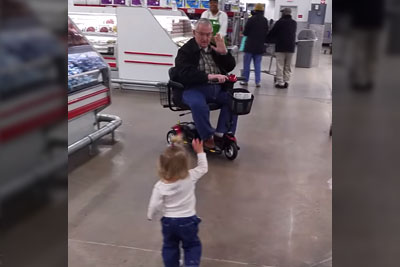 Baby Girl Approaches Stranger At Store, Mom Captures Footage She Won't Soon Forget