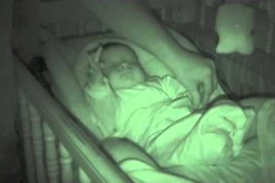 Daddy Tries To Put Infant's Cold Hand Under Blanket, Camera Footage Records Something Odd