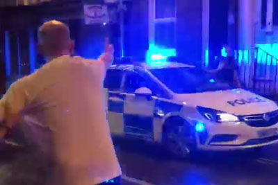 Cop Car Makes The Most Badass Entrance Ever To A Street Disturbance