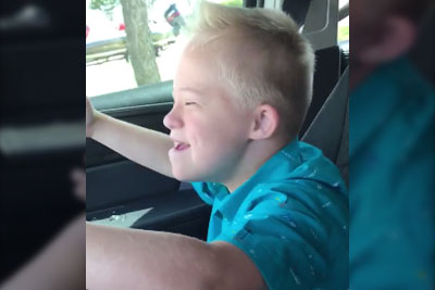 Little Kid With Down Syndrome Goes Viral With Singing Whitney Houston In His Mom's Car